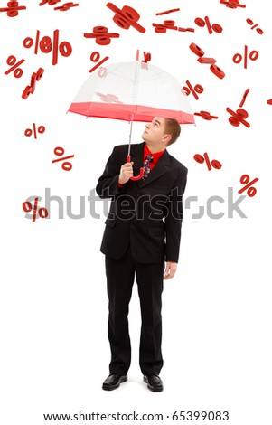 Business man with umbrella, under falling big percents signs - stock photo