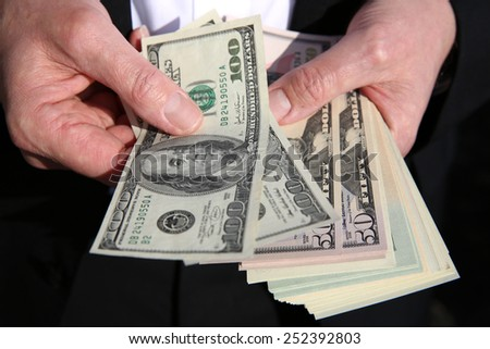 Business Man with US Dollars  - stock photo