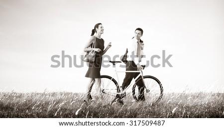 Business Man Woman Pushing Bike Concept - stock photo