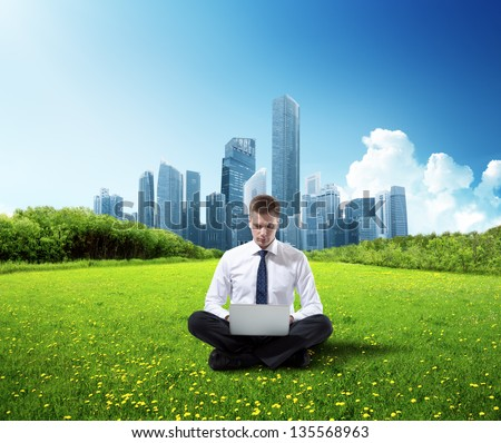 business man working in park - stock photo