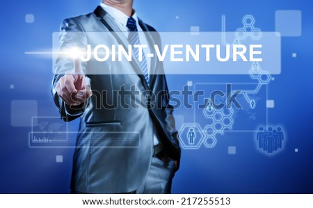Business man working on digital virtual screen press on button Joint venture - stock photo
