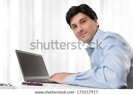 business man working on laptop computer - stock photo