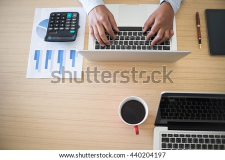 business man working on the laptop at office with copyspace. - stock photo