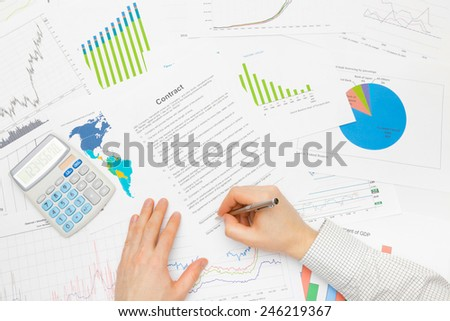 Business man working with financial data - signing contract - stock photo