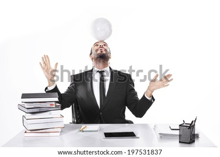 Business man working with soccer ball on his head - stock photo
