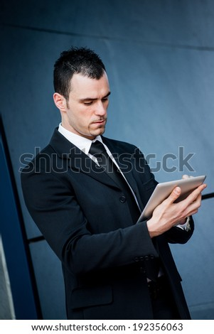 Business man working with tablet  - stock photo