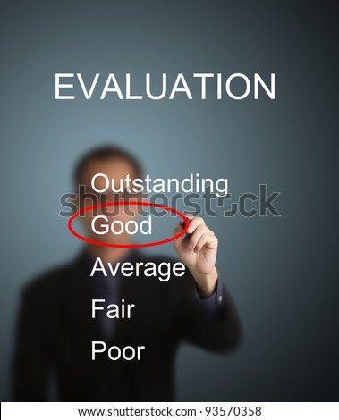 business man write red mark at good choice on evaluation survey form - stock photo