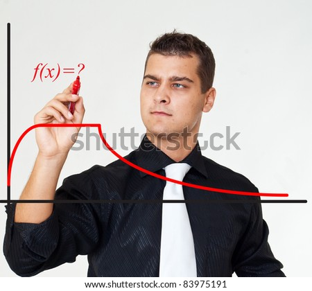 Business man writes red diagrams - stock photo