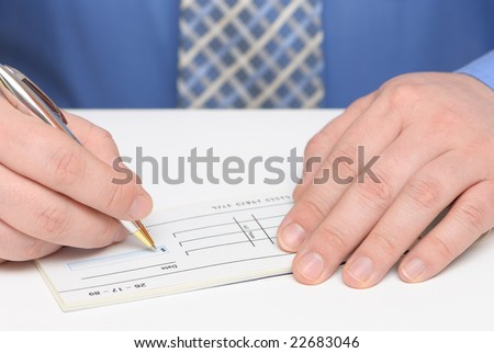 Business man writing a check - stock photo