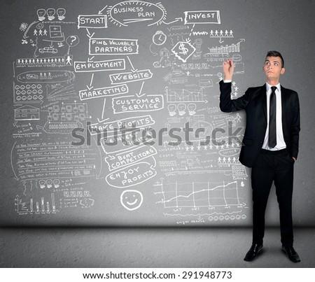 Business man writing business plan - stock photo