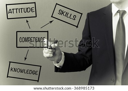 Business man writing - Competence concept - stock photo