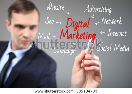 business man writing digital marketing concept - stock photo