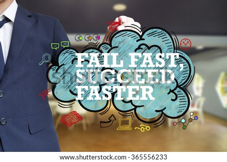 business man writing FAIL FAST SUCCEED FASTER over the cloud with office background , business concept  - stock photo