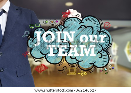 business man writing JOIN OUR TEAM over the cloud with office background , business concept , business idea - stock photo