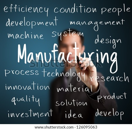 business man writing manufacturing concept - stock photo