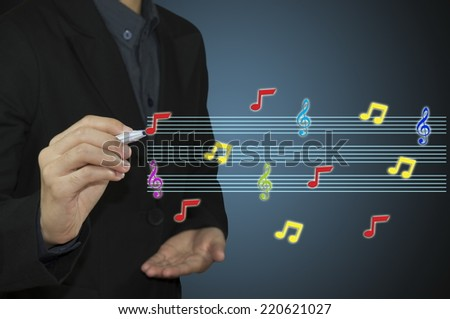 business man writing music notes - stock photo