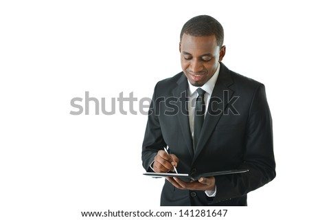 Business man writing notes in his portfolio - stock photo