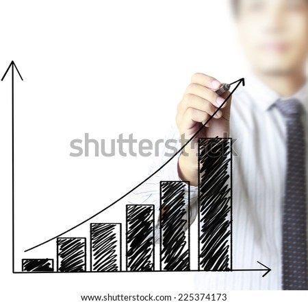business man writing over target graph - stock photo