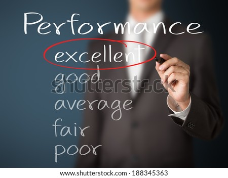 business man writing performance evaluation : excellent - stock photo
