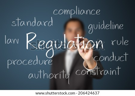 business man writing regulation concept - stock photo