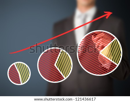 business man writing sharing growth by pie chart - stock photo