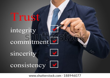 business man writing Trust concept  - stock photo
