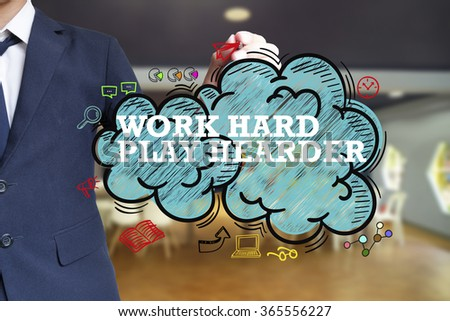business man writing WORK HARD PLAY HARDER over the cloud with office background , business concept  - stock photo