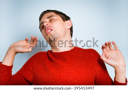 Business man yawning and stretching, isolated on a gray background - stock photo