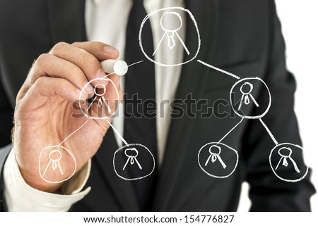 Business manager drawing business hierarchy on virtual screen. - stock photo