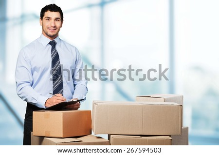 Business. Manager In Warehouse Checking Boxes - stock photo