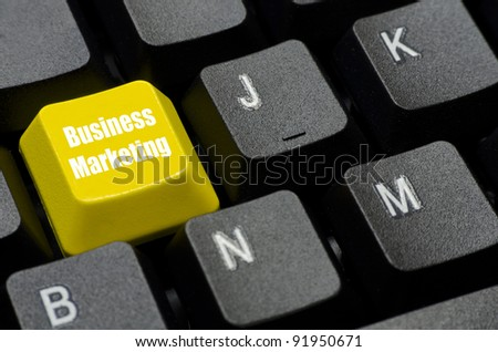business marketing words on yellow and black keyboard button - stock photo