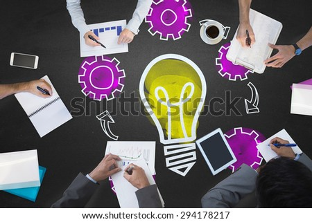 Business meeting against light bulb with cogs - stock photo