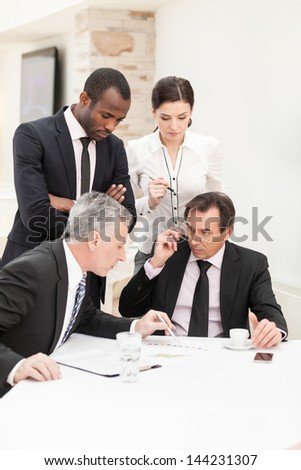 Business meeting - businessman presenting his ideas to colleagues - stock photo