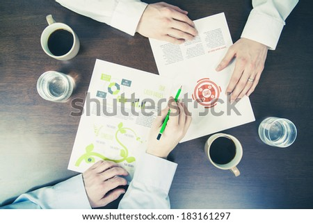 Business meeting concept two men examining documents - stock photo