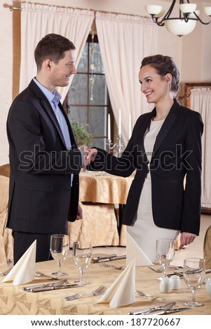 Business meeting in restaurant, two young managers - stock photo