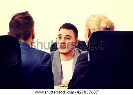 Business meeting-three people sitting and talking - stock photo
