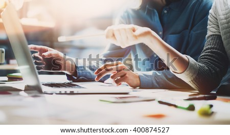 Business meeting time. Photo young account managers crew working with new startup project. Notebook on wood table. Idea presentation, analyze plans. Wide,film effect - stock photo