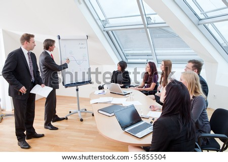 business meeting with seven people at the conference room - stock photo