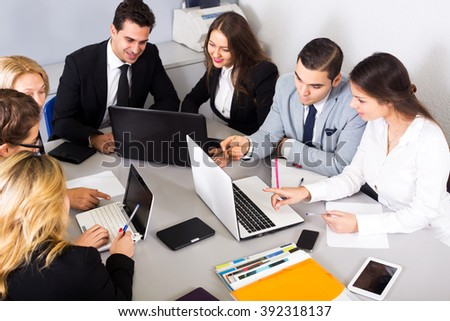 Business members of the multinational business meetings at work in office. Focus on the right man and woman - stock photo