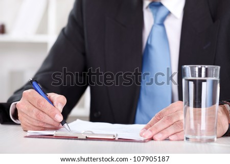 business men hand with pen writing paper document - stock photo