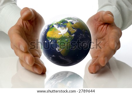 business men holding earth between hands on white - stock photo