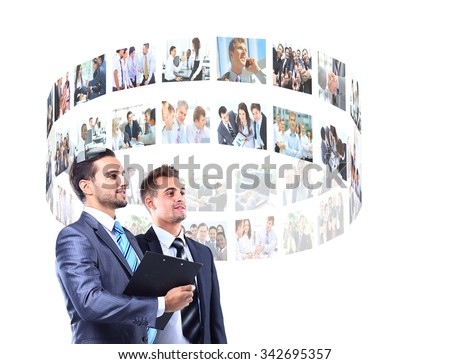 business men looking a virtual buttons - stock photo