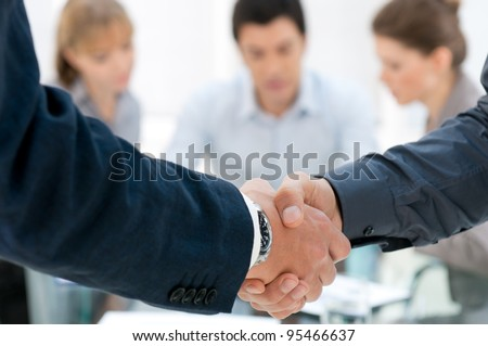 Business men shaking hands after an agreement during a meeting - stock photo