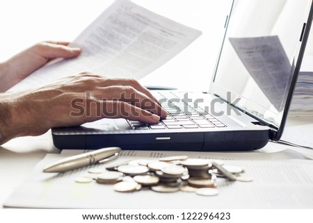 Business men working with documents and computer  in the office - stock photo