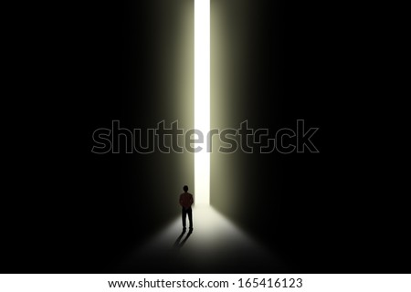 Business Metaphor - businessman walking towards opportunity door - stock photo