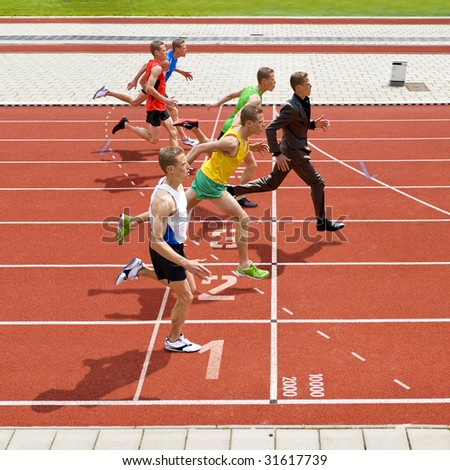 Business metaphore of staying ahead, winning in business,business competition, and continuous improvement, represented by a photo finish of a track race - stock photo