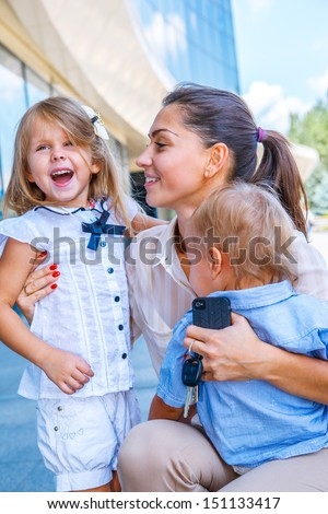 Business mother happy with her children - stock photo