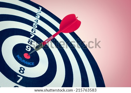 Business motor insurance concept and darts board - stock photo