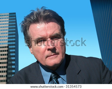 Business Negotiator with two buildings in background. - stock photo