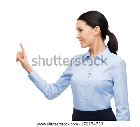 business, new technology and communication concept - businesswoman working with imaginary virtual screen - stock photo